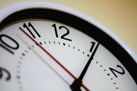 white and black analog clock