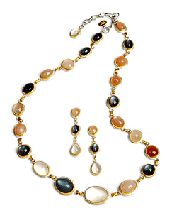 gold-colored necklace and earrings with gemstones