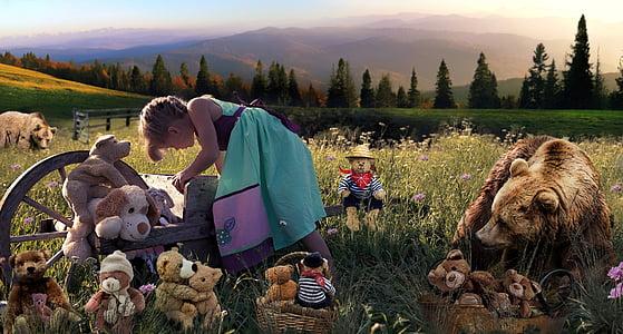 girl near the bear on the open grass field