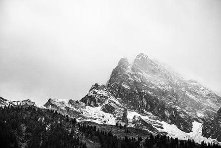 mountain peak during foggy season