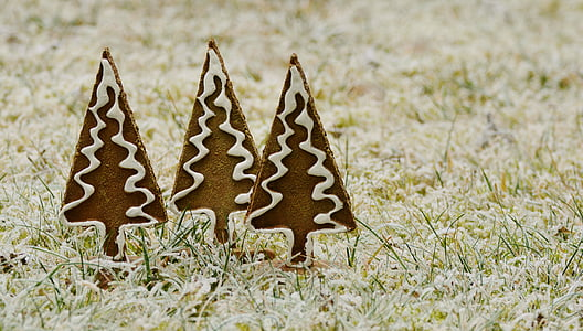 three brown-and-white Christmas tree decors