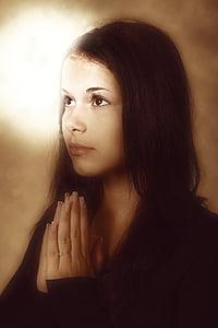 woman wearing black tops praying