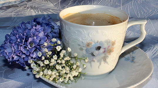 white and purple floral ceramic coffee cup with saucer