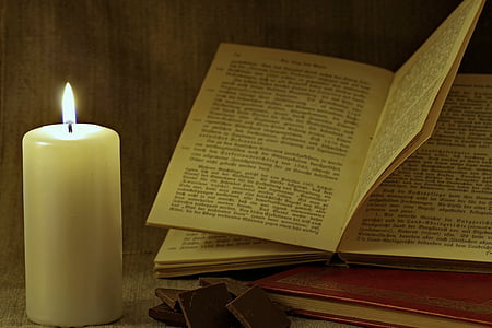 book and candle on table