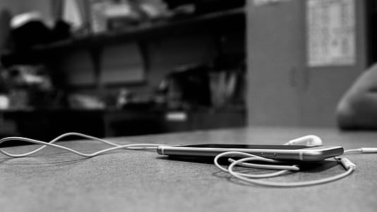 smartphone and earphones on the table