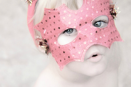 girl in pink masquerade mask