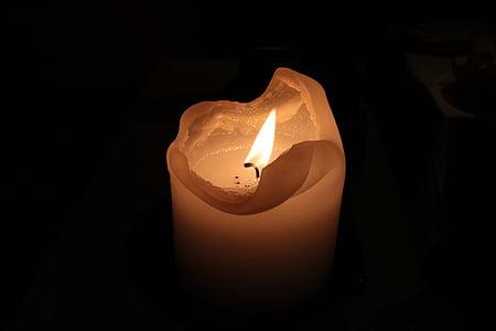 ignited white pillar candle