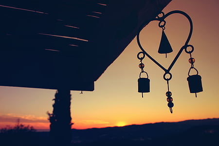 silhouette of wind chimes