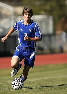 soccer player wearing blue jersey