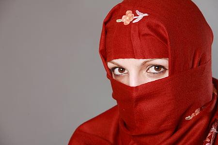 woman wearing red headscarf