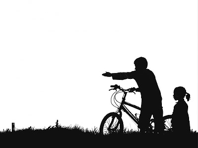 silhouette of man and girl near bike