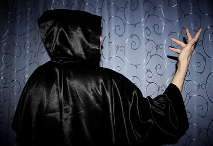 person wearing black hooded dress