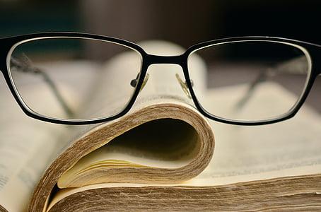 black frame eyeglasses on book page