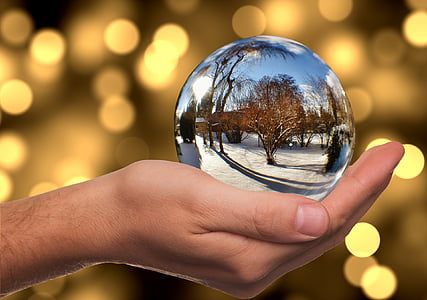 person holding snow globe