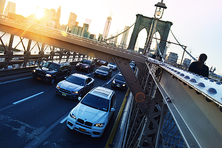 assorted-color vehicle on bridge during daytime