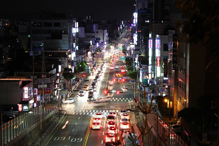 aerial photography of city intersection with buildings and heavy traffic at night