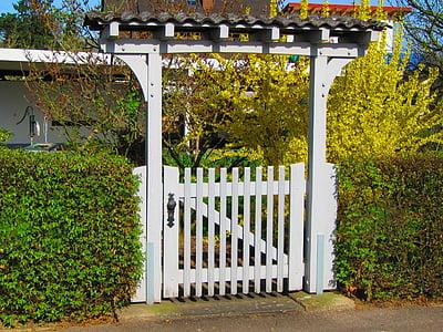 white wooden gate