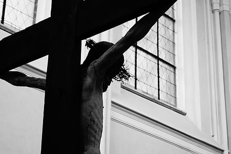 grayscale photography of Jesus Christ with cross statue