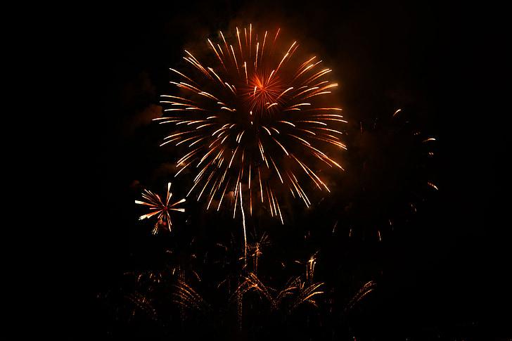 orange fireworks on pitch dark sky
