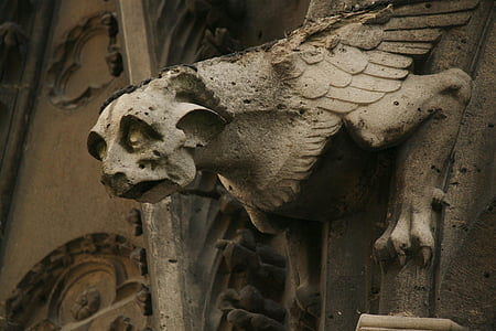 grey winged creature architectural ornament