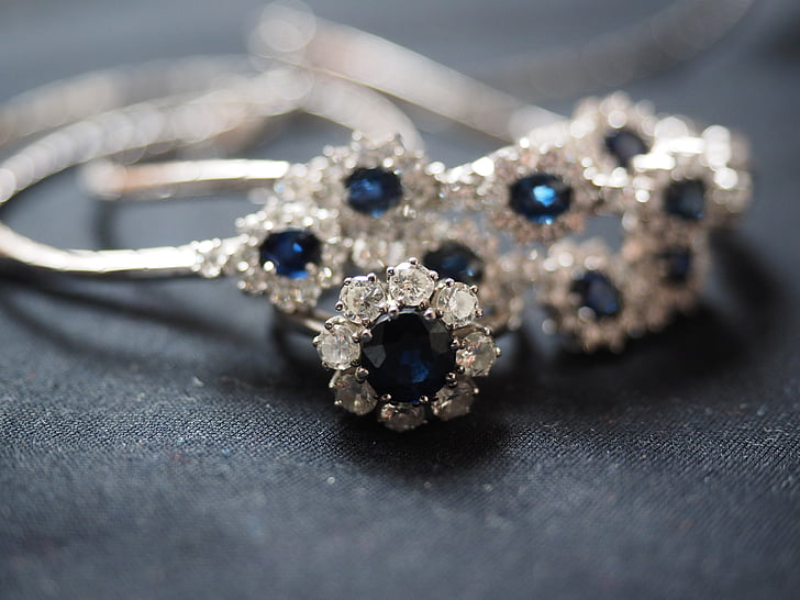 silver-colored, clear, and blue gemstone encrusted accessory