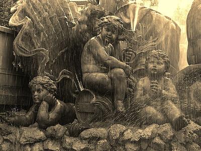 brown cherub statue fountain