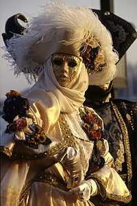 woman wearing masquerade mask and gown