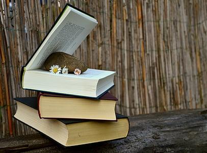 pile of three books