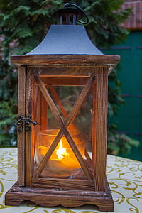 brown wooden candle lantern