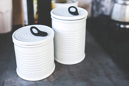 two white ceramic canisters in macro photography