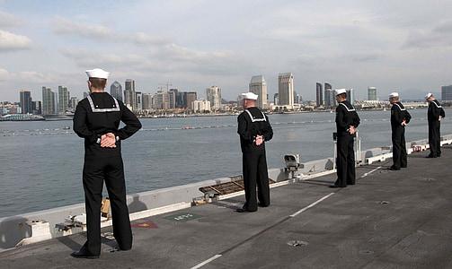 five man in black overalls standing