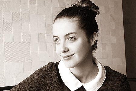 grayscale photo of woman wearing collared shirt