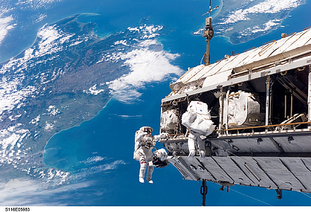 astronaut in space with near earth