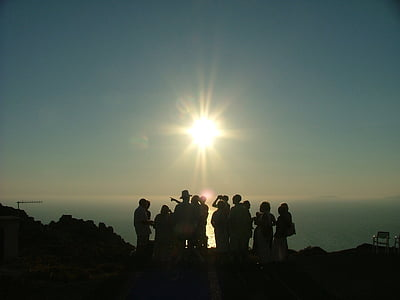 group of person during sunset photography
