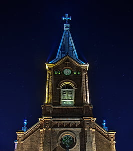 photograph of brown cathedral during night