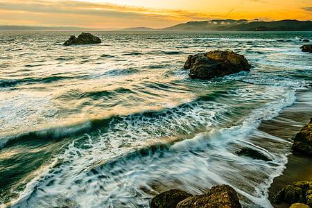 body of water near rock