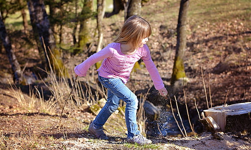 girl about to walk on forest