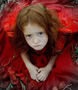 girl wearing red dress while sitting
