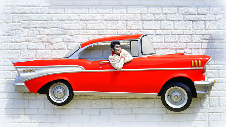 Royalty-Free photo: Elvis Presley on car wall decor   PickPik