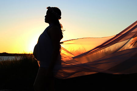 silhouette photography of woman during sunset