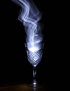 footed glass with smoke