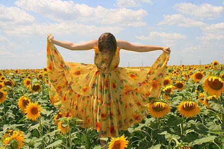 girl wearing yellow dress