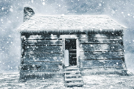 snow covered white wooden house
