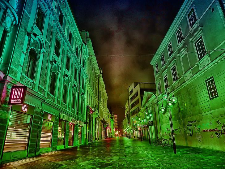 road between concrete buildings digital wallpaper