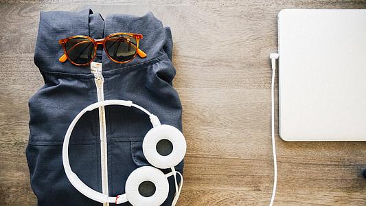 white corded headphones on black textile