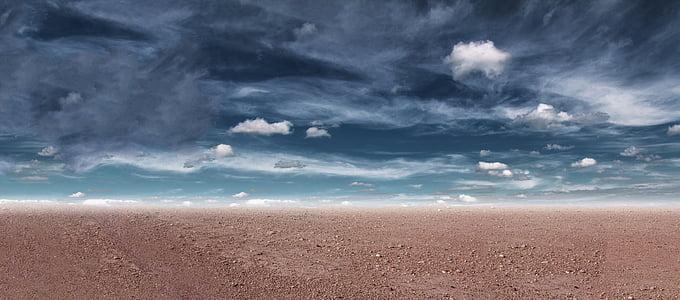 landscape photography of brown soils under cirrus clouds