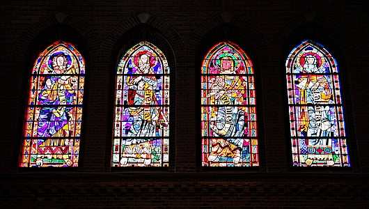 four multicolored stained glasses