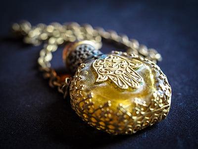 shallow focus photography of hamsa hand engraved pendant