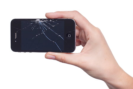 person holding cracked iPhone 4