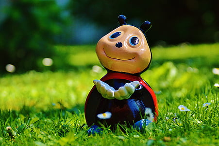 lady Bug figurine on green grass